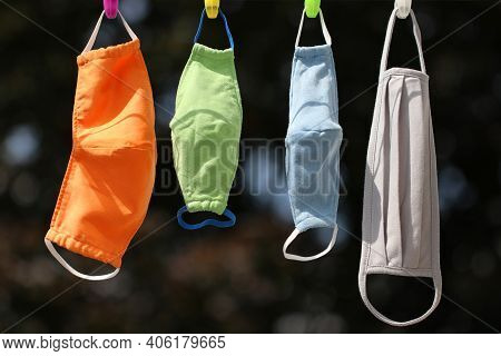 Colourful Handmade Clothing Face Masks For The Whole Family For Adults And Children Hang On A Clothe