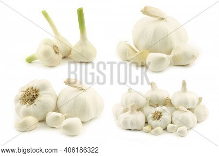 Dried garlic bulbs and some cloves on a white background