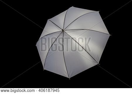 White Silver Reflective Photo Umbrella On A Black Background As An Illustration Or Art Design Elemen