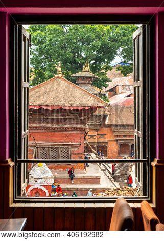 KATHMANDU, NEPAL - CIRCA APRIL 2018: Window with a view on Kathmandu Durbar Square.