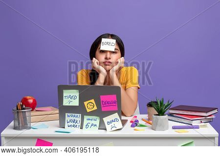 Boredom Concept. Portrait Of Fatigue Tired Indian Woman Sitting At Table With Sticky Notes On Her Fo