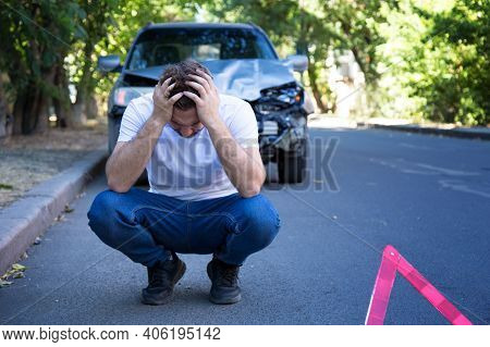 Driver Man In Front Of Wrecked Car In Car Accident. Scared Man Holding His Head After Auto Crash. Tr