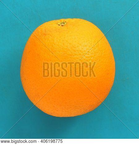 Close Up Of Orange Citrus On Blue Background. Bright Orange Citrus, Fresh Summer Mood. Stock Photo B