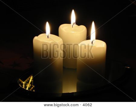 Low Light Photo Of 3 Burning Candles