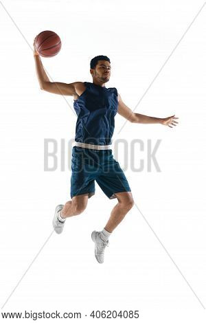 Warrior On The Court. Young Arabian Muscular Basketball Player In Action, Motion Isolated On White B
