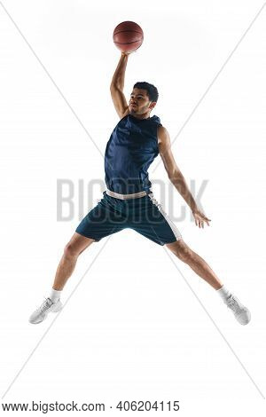 Slam Dunk. Young Arabian Muscular Basketball Player In Action, Motion Isolated On White Background.