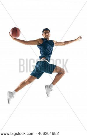 High Flight. Young Arabian Muscular Basketball Player In Action, Motion Isolated On White Background