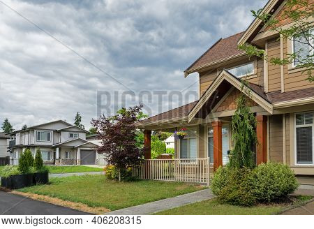 Street View In Suburban Residential Area On Cloudy Sky Background