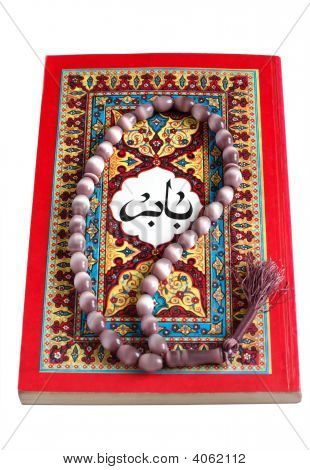 Arabic Book With Rosary Isolated On A White
