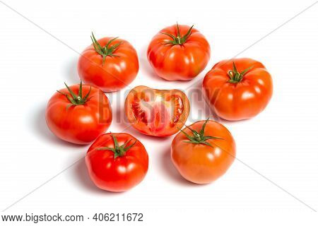 A Group Of Tomatoes On A White Background, With Shadows. One Tomato Cut, Studio Photo, Isolate, Toma
