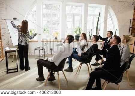 Selfie. Female Speaker Giving Presentation In Hall At University Workshop. Audience Or Conference Ha
