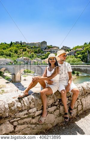 Balazuc In Southern France, Ardeche District France. Couple Mid Age Men And Woman On A Road Trip In