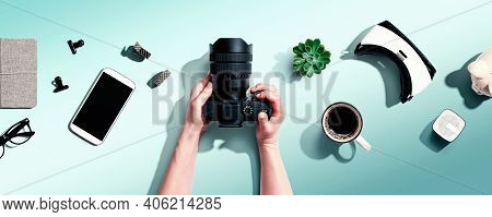 Person Holding A Slr Camera From Above