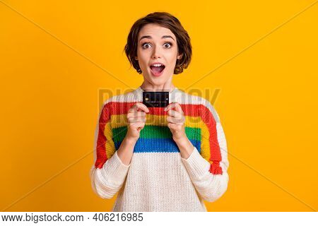 Photo Of Pretty Girl Hold Show Credit Card Open Mouth Wear Striped Pullover Isolated Yellow Color Ba