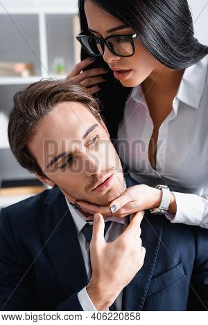 Passionate Brunette Businesswoman Seducing Young Colleague In Office.