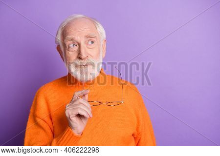 Photo Of Concentrated Aged Person Hold Bite Eyewear Look Empty Space Thinking Isolated On Magenta Co