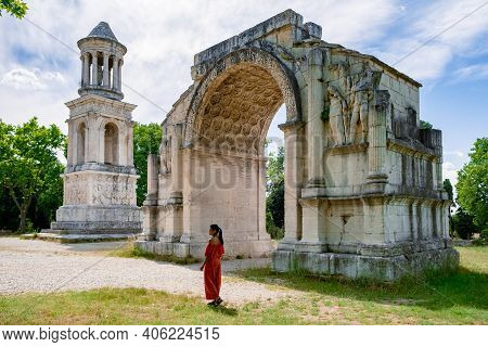 Les Baux De-provence, Provence, France. Couple Mid Age Men And Woman Visiting Old Town Of Les Baux