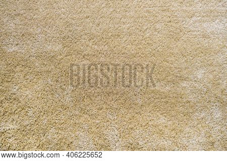 Surface Of Beige Carpet. Frieze Wool Material Carpeting.