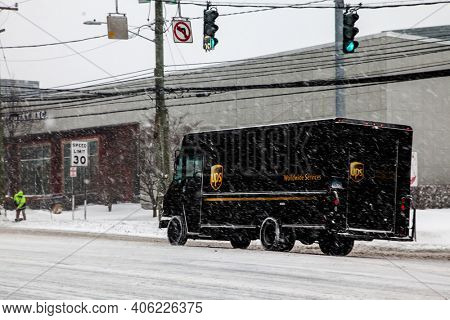 NORWALK, CT, USA-FEBRUARY 1, 2021:  UPS truck delivery during snow day on Connecticut Ave.