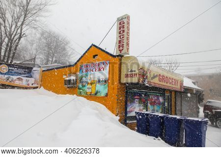NORWALK, CT, USA-FEBRUARY 1, 2021:  Caribbean Grocery in Norwalk on West Cedar Street during snow day.