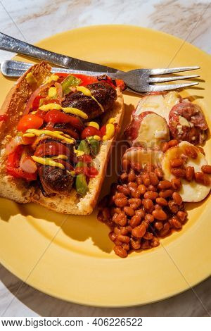 Sausage Onions And Peppers Hoagie Sandwich With Side Of Baked Beans And German Potato Salad