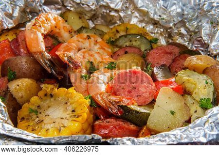 American Surf And Turf Dinner Cooked And Served In Tin Foil Packet Featuring Shrimp Multicolored New