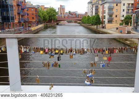 Leeds, Uk - July 12, 2016: Love Padlocks On A Foot Bridge Crossing River Aire In The Calls, Former I