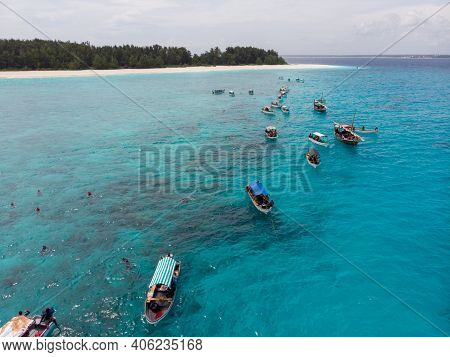 Aerial View Of Boats Staying Near Mnemba Atoll In Zanzibar - The Famous Spot For Snorkeling And Boat