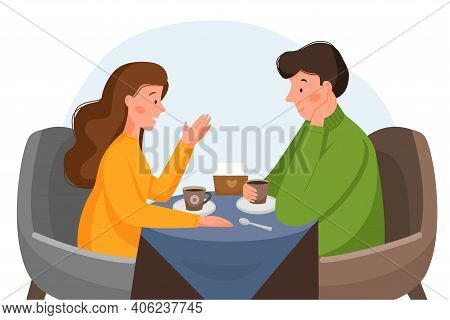 A Guy And A Girl Are Sitting In A Cafe, Drinking Coffee And Talking. Man And Woman In A Cafe. First