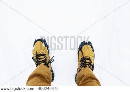 Trekking Shoes On Snow. Winter Mountain Trekking. White Ground Covered With Snow. Walking On Snow Ro