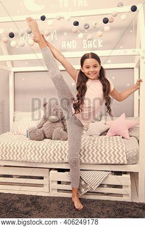 Improving Flexibility Through Pilates Training. Little Gymnast Training In Nursery. Gymnastic Traini