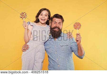 Let Fathers Day Begin. Happy Family Yellow Background. Father And Daughter Hold Lollipops. Fathers D