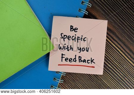 Be Specific With You Feedback Write On Sticky Notes Isolated On Wooden Table.