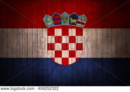 Croatian Flag With The Sign On A Wooden Background