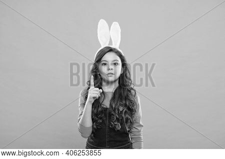 Easter Marketing Campaign. Bunny Girl Pointing Up. Little Child Pointing Index Finger. Pointing Gest