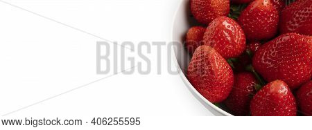 Red Strawberries In White Bowl Isolated Close Up. Ananassa Strawberry In Soup Plate On White Backgro