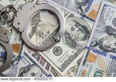 Handcuffs On Money Background. Dollar Bills, Money Cash Corruption, Dirty Money Financial Crime And