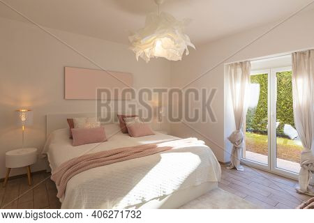 Modern, bright and luxury bedroom in design apartament. Fresh bed sheets and pillows above. Minimal and elegant.