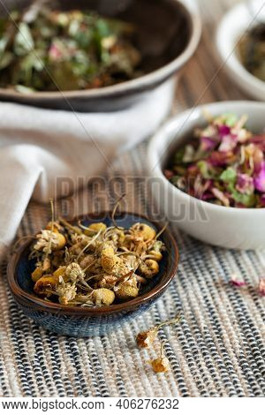 Healing Dried Herbs And Flowers In Ceramic Bowl Close-up. Homeopathy And Herbal Alternative Medicine
