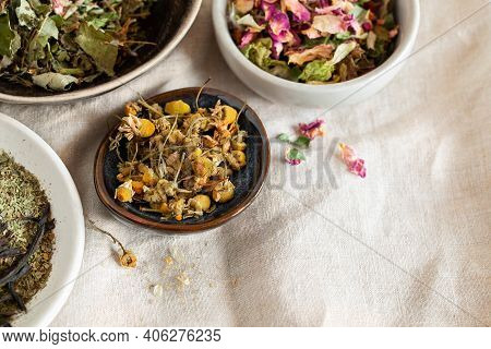 Different Kinds Of Herbal Tea In Ceramic Bowl Top View. Home Remedy Concept