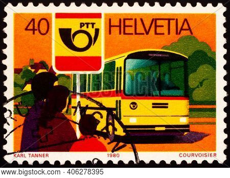 Moscow, Russia - February 01, 2021: Stamp Printed In Switzerland Shows Post Omnibus And Bus Stop, Se