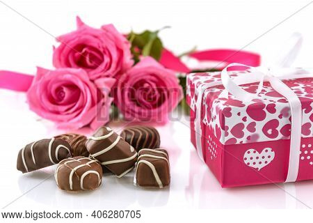 Chocolates Pralines, Gift Box And Pink Rose On The White Background. Valentine's Day And Women's Day