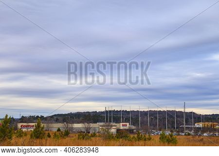 Augusta, Ga Usa - 01 07 21: Costco Wholesale Club And A Golf Net With Cloudy Blue Sky