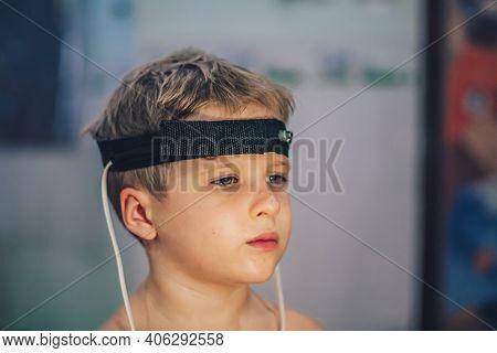 Express Biofeedback Microcurrent Rezonans Health Of Organs Diagnostic. Sick Child Boy Wear Bioresona