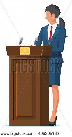 Orator Speaking From Tribune. Public Speaker. Wooden Rostrum With Microphones For Presentation. Stan