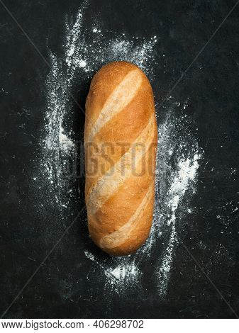 British White Bloomer Or European Baton Loaf Bread On Black Background. Top View Or Flat Lay. Copy S