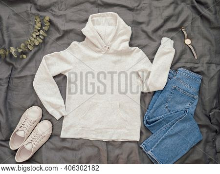 Fashionable Look With White Empty Hoody, Jeans And White Sneakers. Top View Of White Blank Hoody Wit