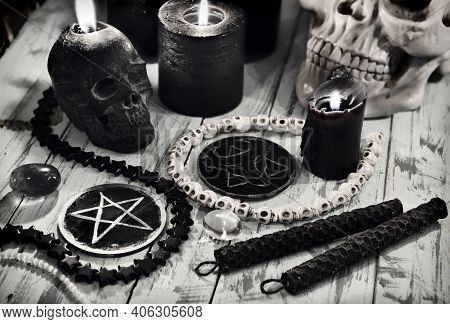Evil Still Life With Black Candles And Scary Symbols Of Devil With Pentagram.  Esoteric, Gothic And