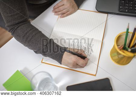 Woman Taking Training Course In Mental Care And Writing Down List Of Rules For Mental Health To Redu