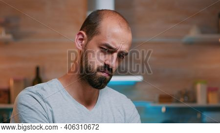 Tired Man Squinting Eyes Looking At Laptop Screen Trying To Focus Concentrate. Busy Focused Employee
